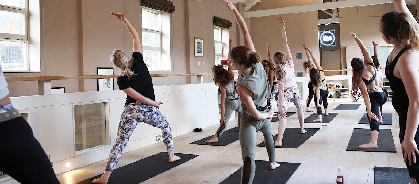 yoga class in pink soda sport